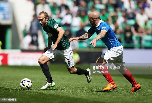 Dylan McGeouch of Hibernian competes with Nicky Law of Rangers during the Scottish Championship play off semi final second leg match between...