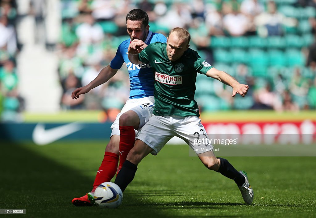 Dylan McGeouch of Hibernian vies with Nicky Law of Rangers controls the ball during the Scottish Championship play off semi final, second leg match between Hibernian and Rangers at Easter Road on May 23, 2015 in Edinburgh, Scotland.