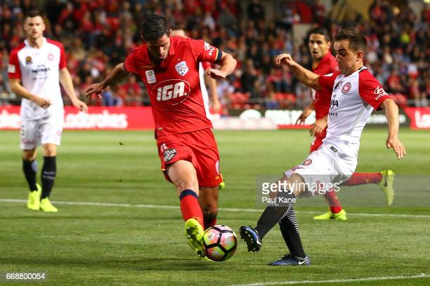 Dylan McGowan of Adelaide and Steven Lustica of the Wanderers contest for the ball during the round 27 ALeague match between Adelaide United and the...