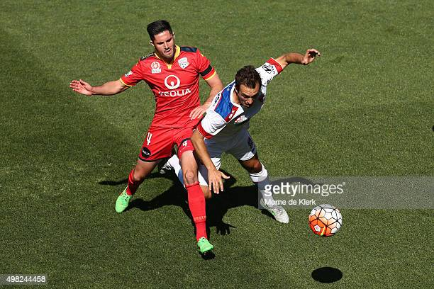 Dylan McGowan of Adelaide United competes with Ben Kantarovski of Newcastle Jets during the round seven ALeague match between Adelaide United and the...