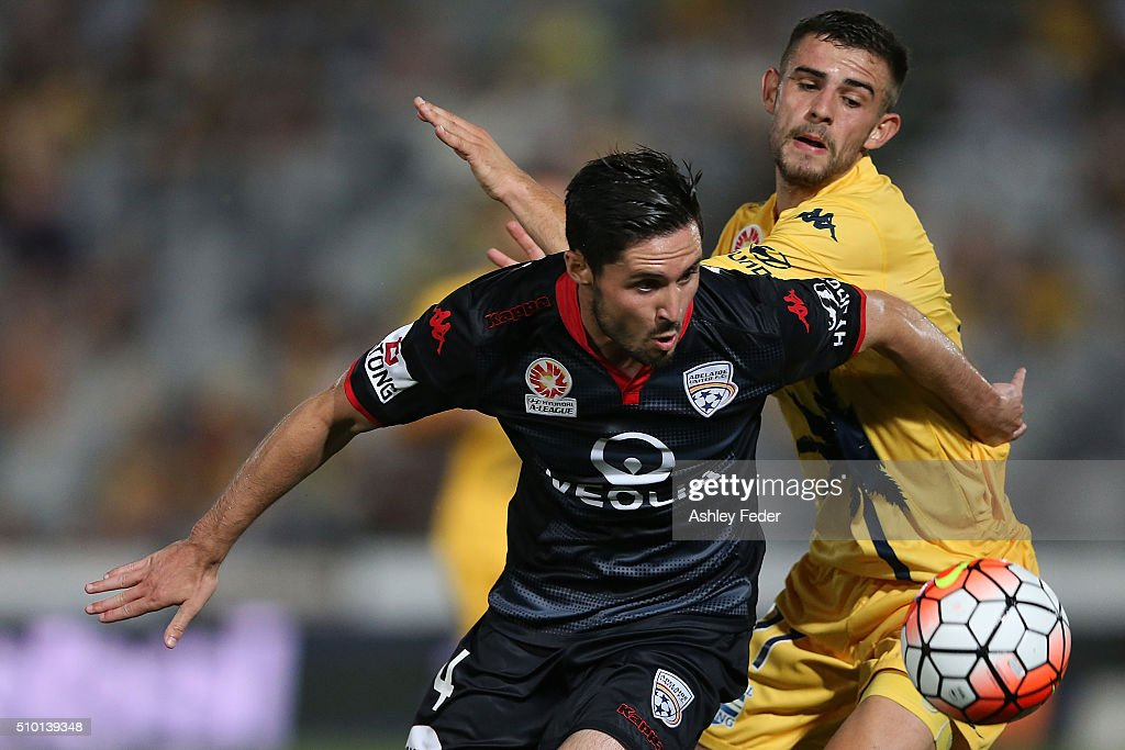 Dylan McGowan of Adelaide United contests the ball against Michael Neill of the Mariners during the round 19 A-League match between the Central Coast Mariners and Adelaide United at Central Coast Stadium on February 14, 2016 in Gosford, Australia.