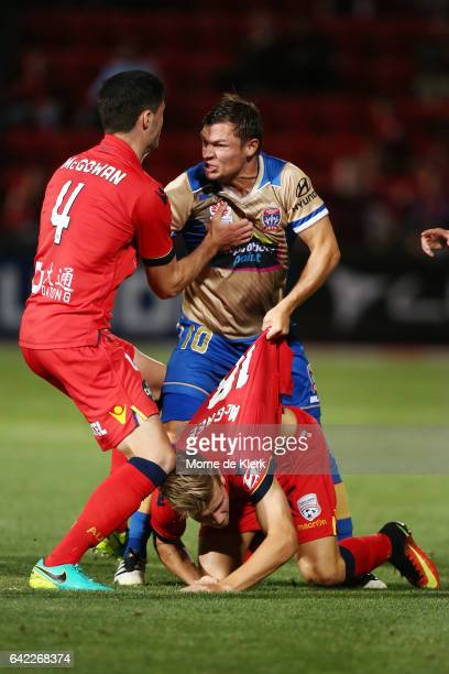Dylan McGowan of Adelaide United pushes Wayne Brown of the Jets after he pushed Riley McGree of Adelaide United during the round 20 ALeague match...