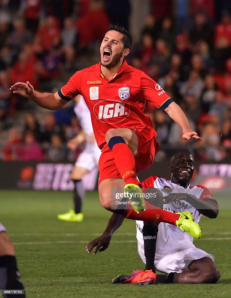 Dylan McGowan of United is tackled by Manyiel Riel Majok of the Wanderers during the round 27 A-League match between Adelaide United and the Western Sydney Wanderers at Coopers Stadium on April 15, 2017 in Adelaide, Australia.