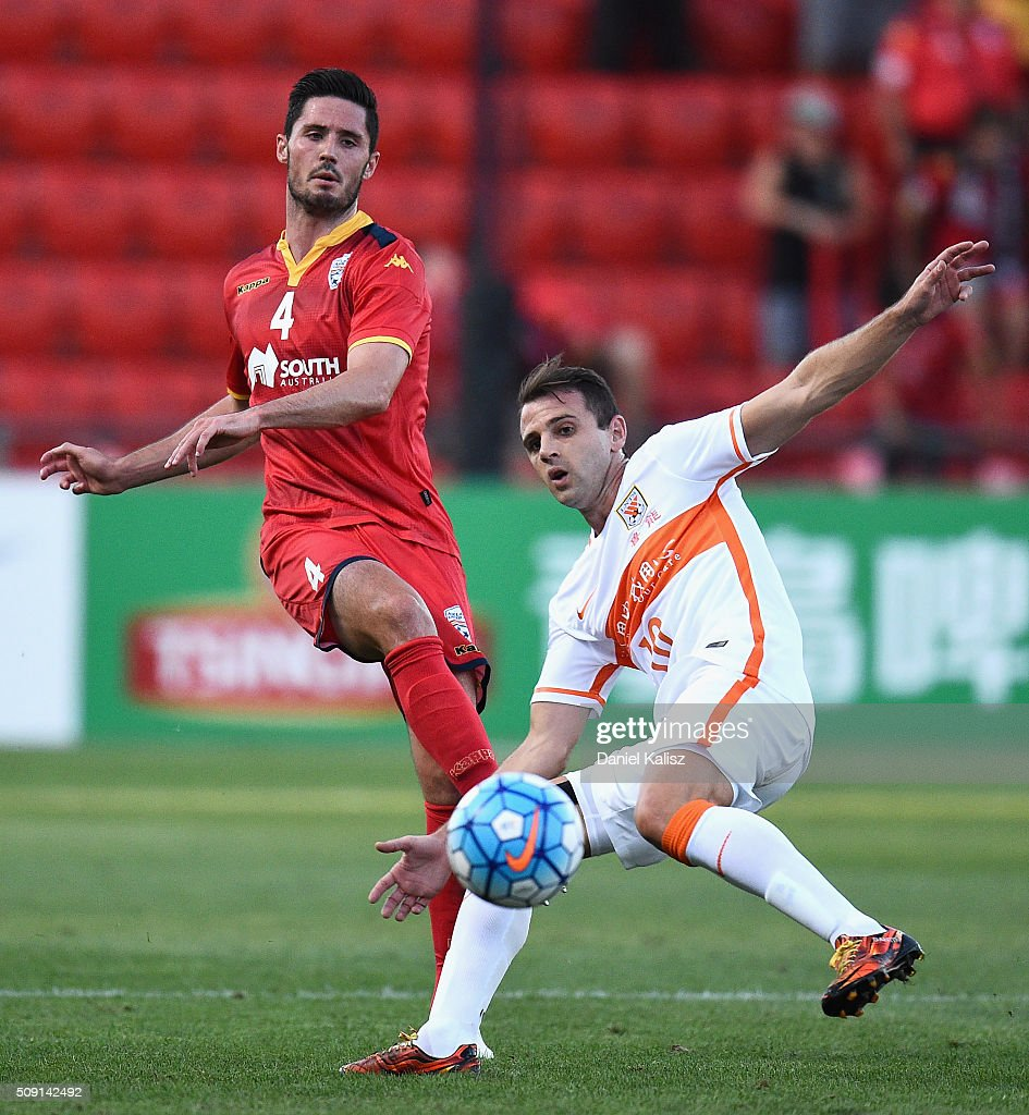 Dylan McGowan of United strikes the ball during the AFC Champions League playoff match between Adelaide United and Shandong Luneng at Coopers Stadium on February 9, 2016 in Adelaide, Australia.