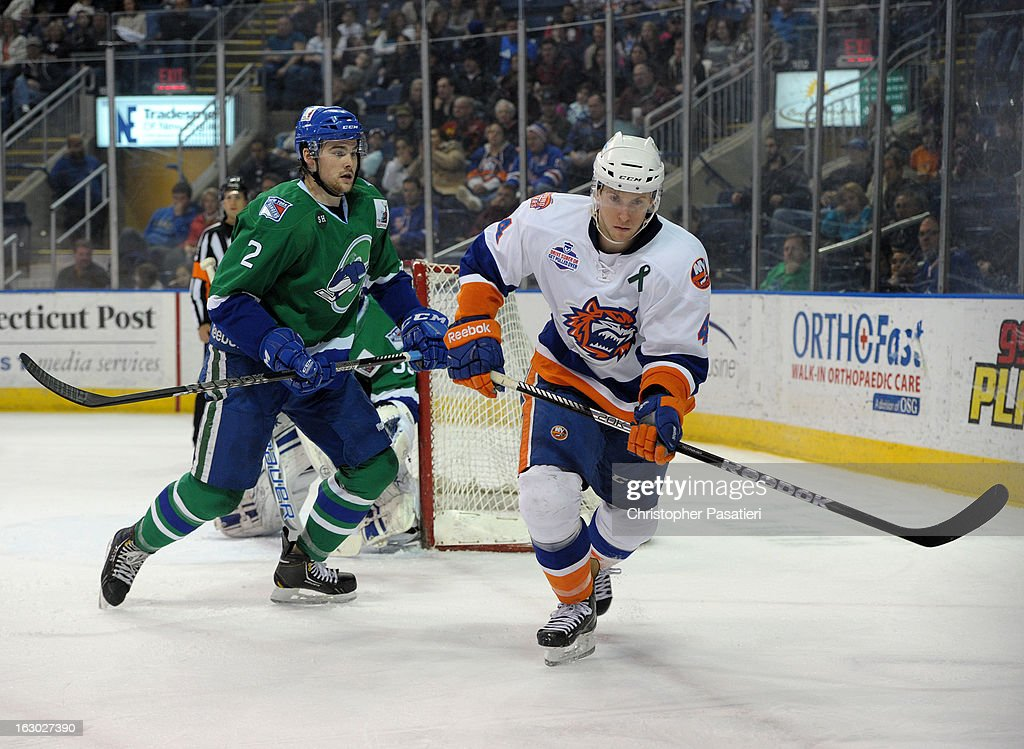 Dylan McIlrath #2 of the Connecticut Whale skates against Scott Campbell #4 of the Bridgeport Sound Tigers during an American Hockey League game on March 3, 2013 at the Webster Bank Arena at Harbor Yard in Bridgeport, Connecticut.