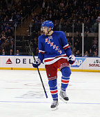 Dylan McIlrath of the New York Rangers celebrates his first NHL goal against the Edmonton Oilers at 754 of the second period at Madison Square Garden...