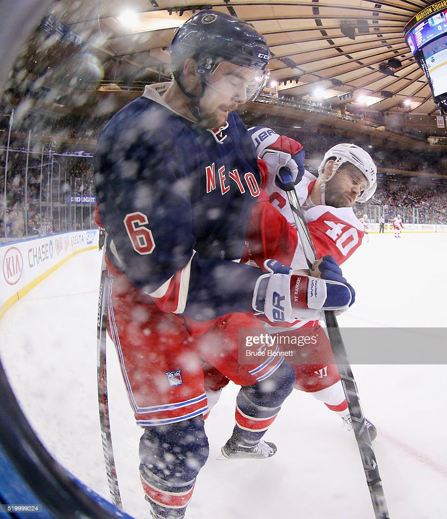 Dylan McIlrath #6 of the New York Rangers is checked by Henrik Zetterberg #40 of the Detroit Red Wings during the first period at Madison Square Garden on April 9, 2016 in New York City.