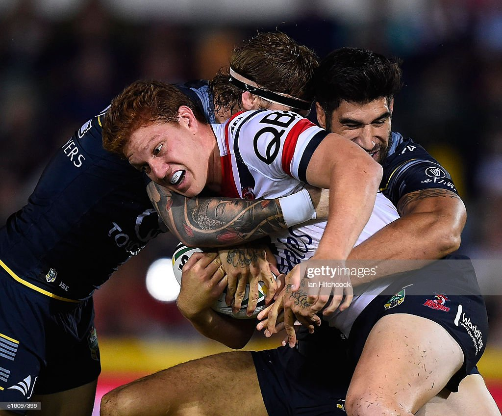 Dylan Napa of the Roosters is tackled by James Tamou and Ethan Lowe of the Cowboys during the round three NRL match between the North Queensland Cowboys and the Sydney Roosters at 1300SMILES Stadium on March 17, 2016 in Townsville, Australia.