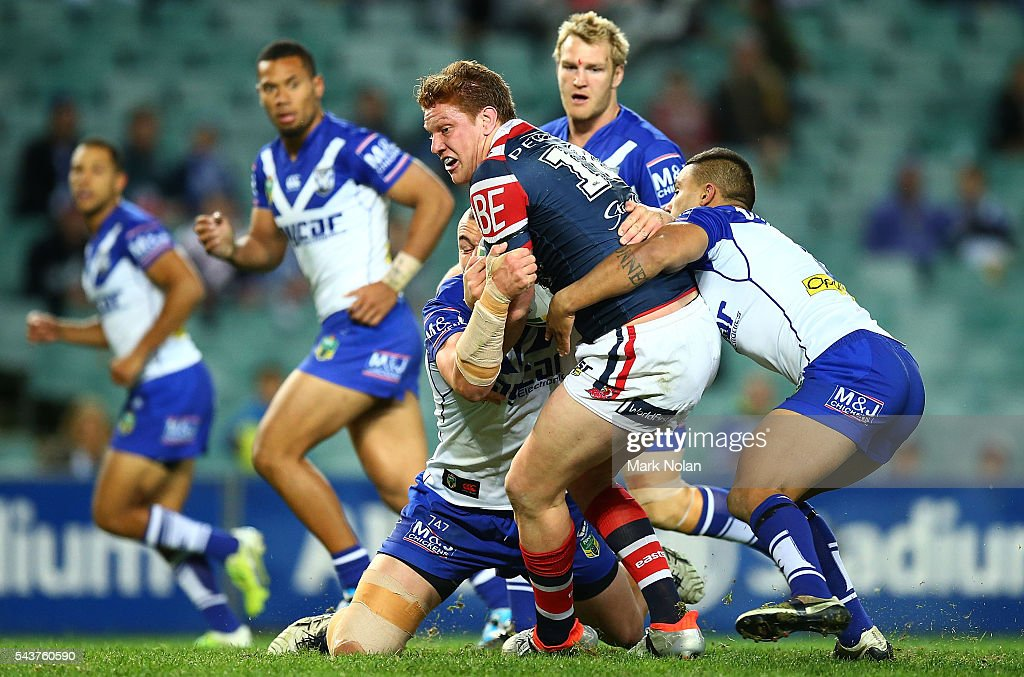 Dylan Napa of the Roosters is tackled during the round 17 NRL match between the Sydney Roosters and the Canterbury Bulldogs at Allianz Stadium on June 30, 2016 in Sydney, Australia.