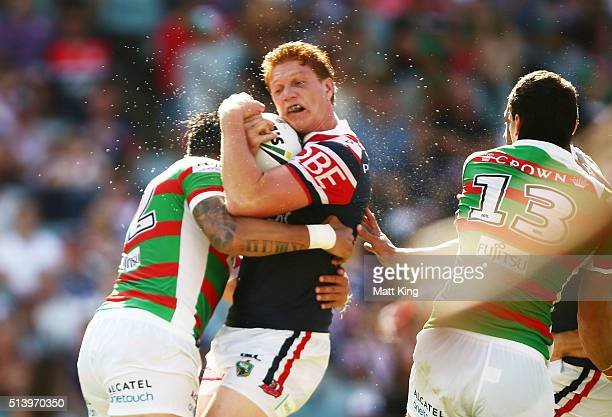 Dylan Napa of the Roosters is tackled during the round one NRL match between the Sydney Roosters and the South Sydney Rabbitohs at Allianz Stadium on...