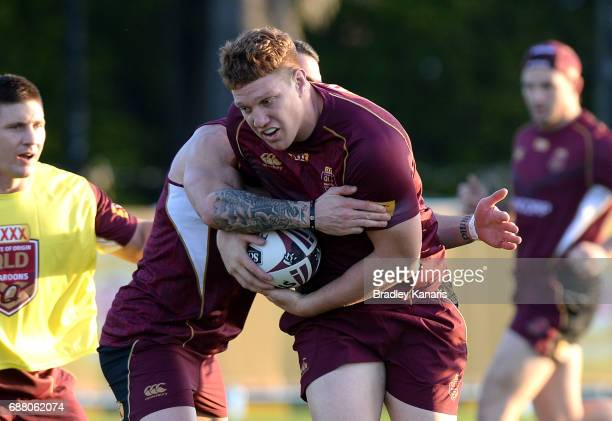 Dylan Napa takes on the defence during a Queensland Maroons State of Origin training session at InterContinental Sanctuary Cove Resort Training Field...
