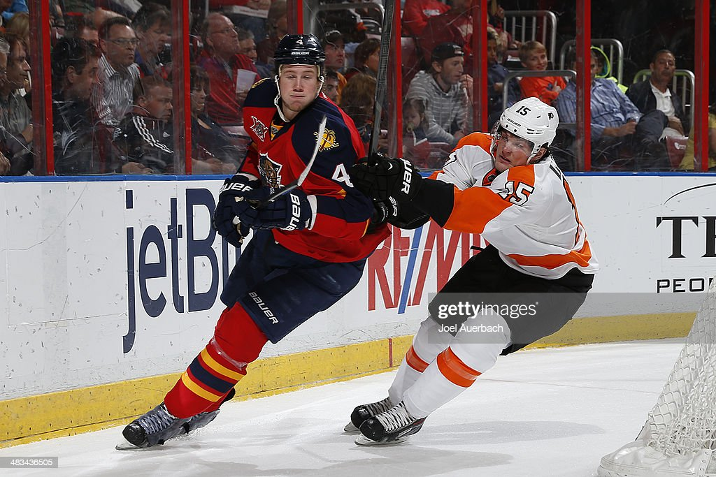 Dylan Olsen #4 of the Florida Panthers and Tye McGinn #15 of the Philadelphia Flyers circle the net during second period action at the BB&T Center on April 8, 2014 in Sunrise, Florida.