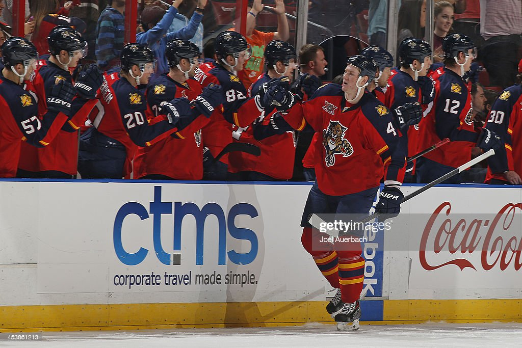 <a gi-track='captionPersonalityLinkClicked' href=/galleries/search?phrase=Dylan+Olsen&family=editorial&specificpeople=5894613 ng-click='$event.stopPropagation()'>Dylan Olsen</a> #4 of the Florida Panthers is congratulated after scoring a second period goal against the Winnipeg Jets at the BB&T Center on December 5, 2013 in Sunrise, Florida. The Panthers defeated the Jets 5-2. Olsen's goal was his first in the NHL.