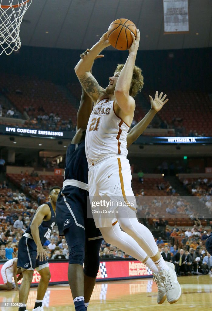 Dylan Osetkowski #21 of the Texas Longhorns is fouled while shooting against the New Hampshire Wildcats at the Frank Erwin Center on November 14, 2017 in Austin, Texas.