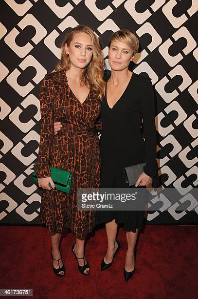 Dylan Penn and actress Robin Wright attend Diane Von Furstenberg's 'Journey Of A Dress' Premiere Opening Party at Wilshire May Company Building on...