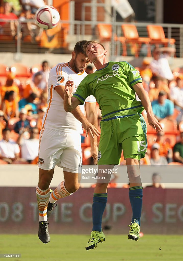 Dylan Remic #15 of the Seattle Sounders FC and Will Bruin #12 of the Houston Dynamo battle for the ball in the first half of their game at BBVA Compass Stadium on October 18, 2015 in Houston, Texas.
