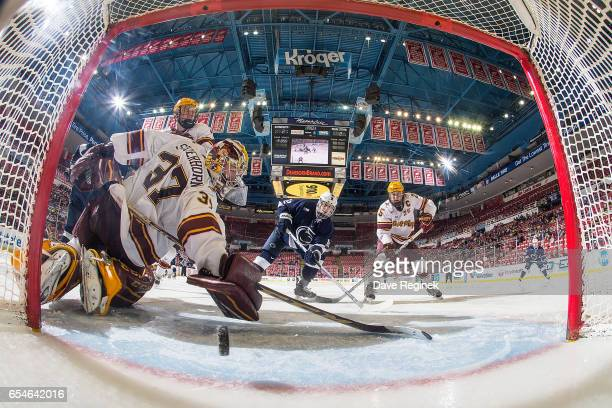 Dylan Richard of the Penn State Nittany Lions scores a third period goal on Eric Schierhorn of the Minnesota Golden Gophers during game two of the...