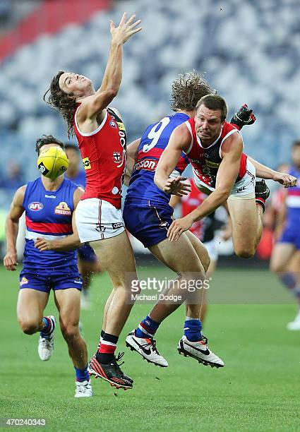 Dylan Roberton and Jarryn Geary of the Saints contest for the ball against Jake Stringer of the Bulldogs during the round two AFL NAB Challenge Cup...