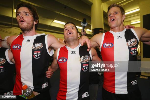 Dylan Roberton Leigh Montagna and Nick Riewoldt of the Saints sing the club song after winning during the round 14 AFL match between the St Kilda...