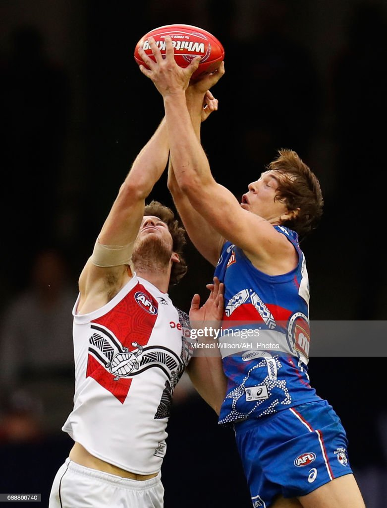 Dylan Roberton of the Saints and Liam Picken of the Bulldogs compete for the ball during the 2017 AFL round 10 match between the Western Bulldogs and the St Kilda Saints at Etihad Stadium on May 27, 2017 in Melbourne, Australia.