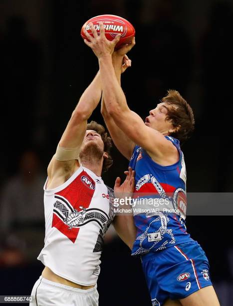 Dylan Roberton of the Saints and Liam Picken of the Bulldogs compete for the ball during the 2017 AFL round 10 match between the Western Bulldogs and...