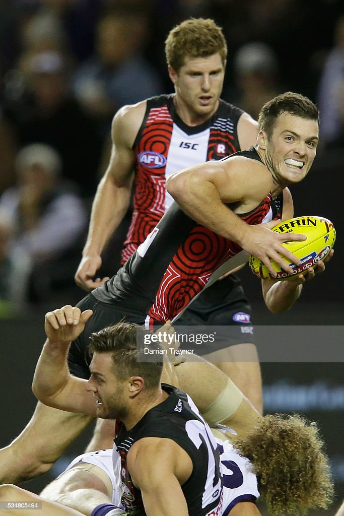 Dylan Roberton of the Saints gathers the ball during the round 10 AFL match between the St Kilda Saints and the Fremantle Dockers at Etihad Stadium on May 28, 2016 in Melbourne, Australia.