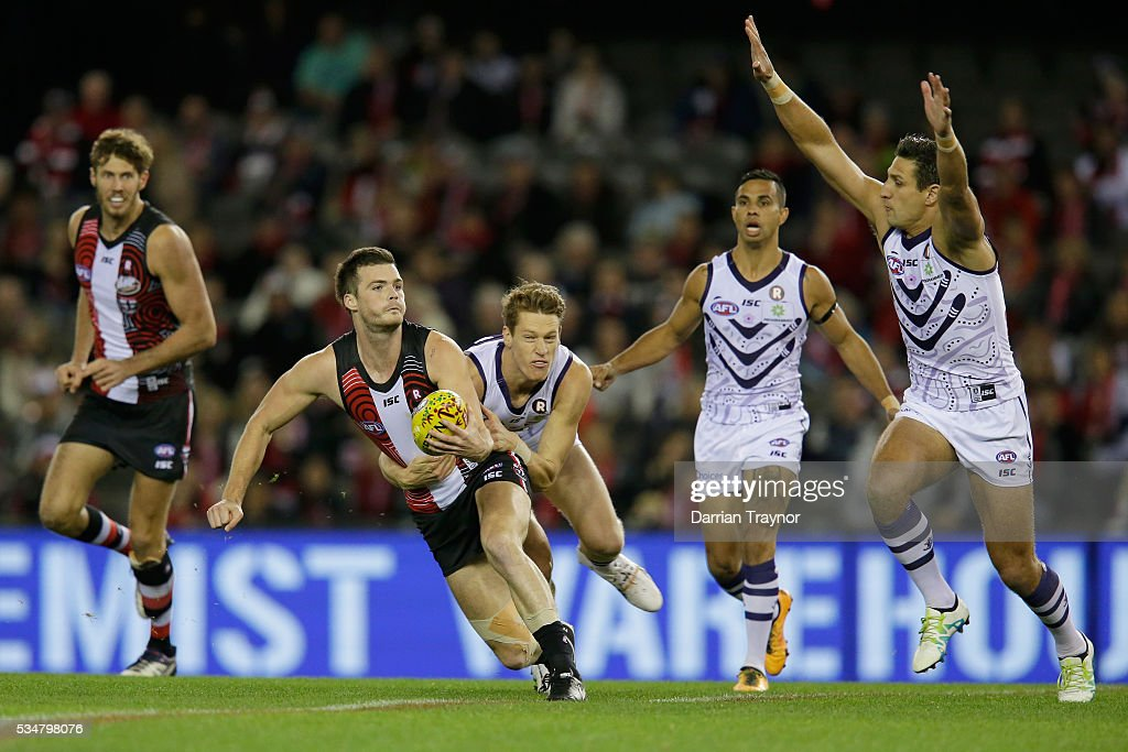 Dylan Roberton of the Saints is tackled by Matt Taberner of the Dockers during the round 10 AFL match between the St Kilda Saints and the Fremantle Dockers at Etihad Stadium on May 28, 2016 in Melbourne, Australia.