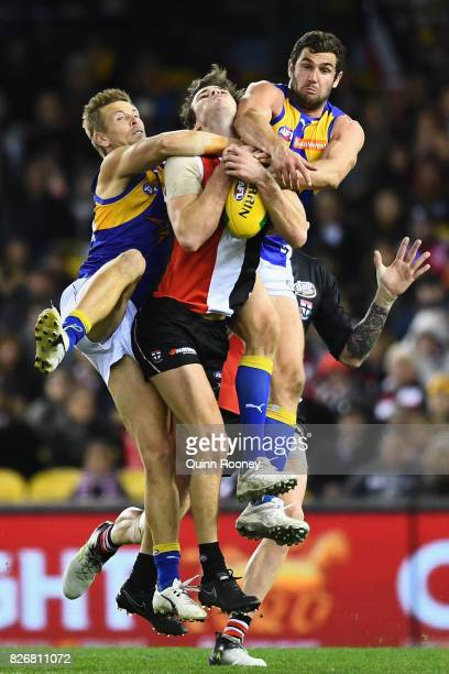 Dylan Roberton of the Saints marks infront of Mark LeCras and Jack Darling of the Eagles during the round 20 AFL match between the St Kilda Saints...