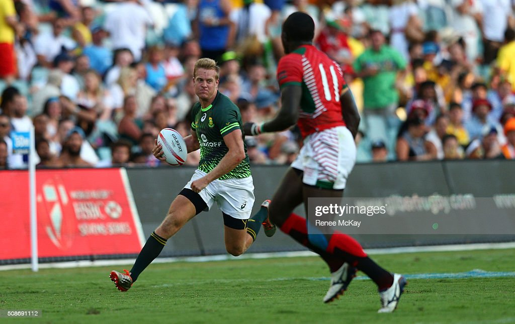 Dylan Sage of South Africa comes up against Collins Injera of Kenya during the day 1 match between South Africa and Kenya at the HSBC Sydney Sevens at Allianz Stadium on February 06, 2016 in Sydney, Australia.