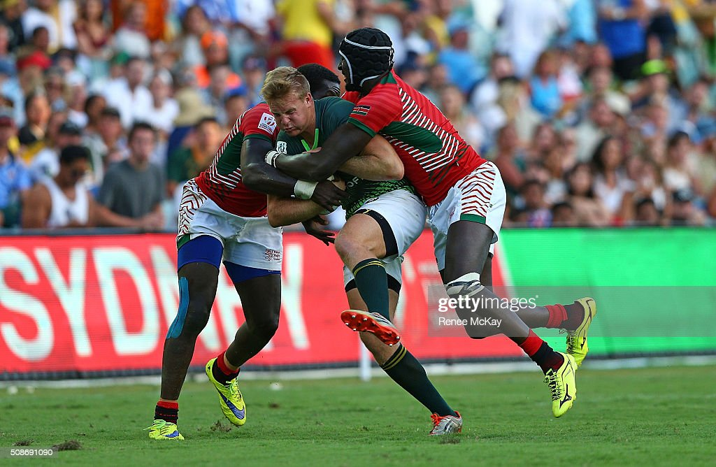 Dylan Sage of South Africa is tackled by the Kenyan defence during the day 1 match between South Africa and Kenya at the HSBC Sydney Sevens at Allianz Stadium on February 06, 2016 in Sydney, Australia.
