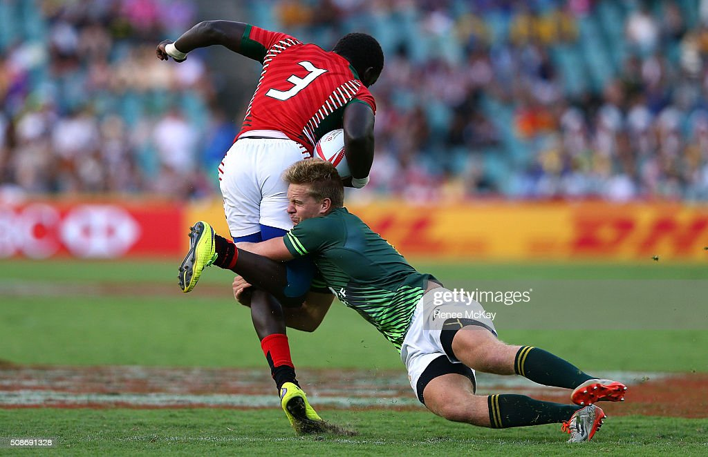 Dylan Sage of South Africa makes a tackle on Oscar Ouma of Kenya during the day 1 match between South Africa and Kenya at the HSBC Sydney Sevens at Allianz Stadium on February 06, 2016 in Sydney, Australia.