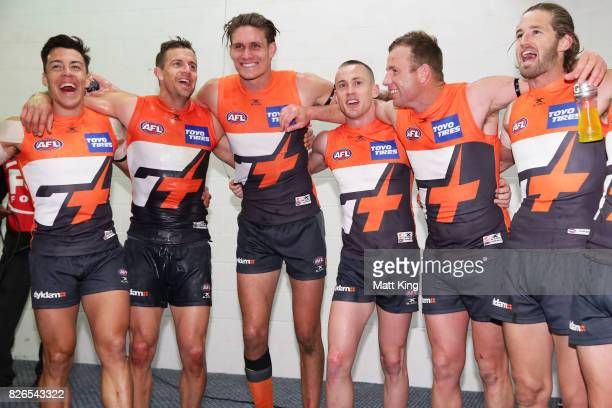 Dylan Shiel Brett Deledio Rory Lobb Tom Scully Steve Johnson and Callan Ward of the Giants celebrate victory and sing the club song after the round...