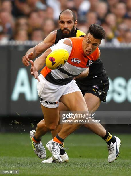 Dylan Shiel of the Giants and Bachar Houli of the Tigers in action during the 2017 AFL Second Preliminary Final match between the Richmond Tigers and...