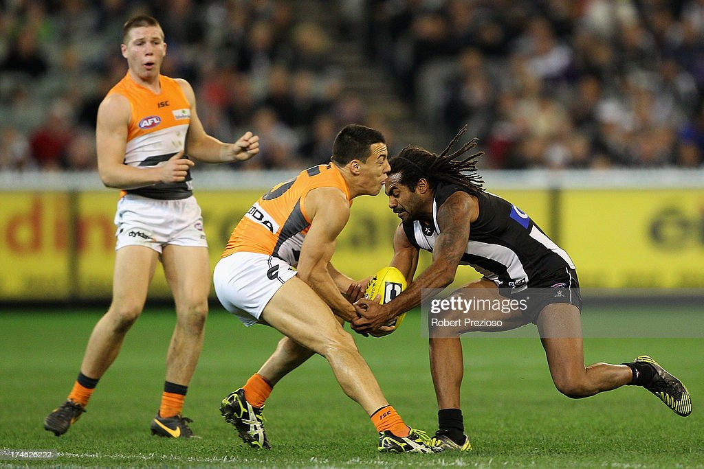 Dylan Shiel of the Giants and Harry O'Brien of the Magpies contest the ball during the round 18 AFL match between the Collingwood Magpies and the Greater Western Sydney Giants at Melbourne Cricket Ground on July 27, 2013 in Melbourne, Australia.