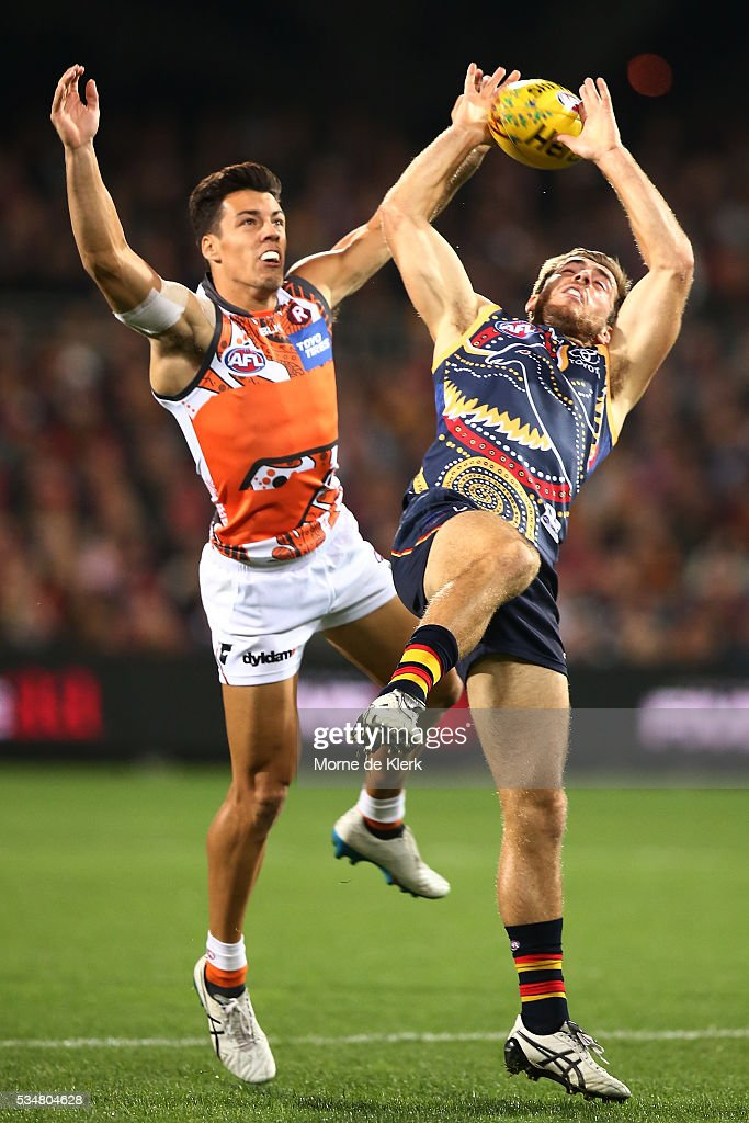 Dylan Shiel of the Giants competes with Richard Douglas of the Crows during the round 10 AFL match between the Adelaide Crows and the Greater Western Sydney Giants at Adelaide Oval on May 28, 2016 in Adelaide, Australia.