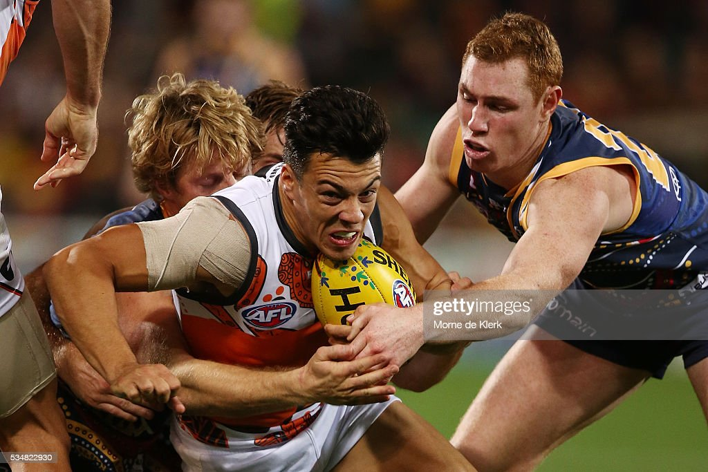 Dylan Shiel of the Giants is tackled by Rory Sloane and Tom Lynch of the Crows during the round 10 AFL match between the Adelaide Crows and the Greater Western Sydney Giants at Adelaide Oval on May 28, 2016 in Adelaide, Australia.