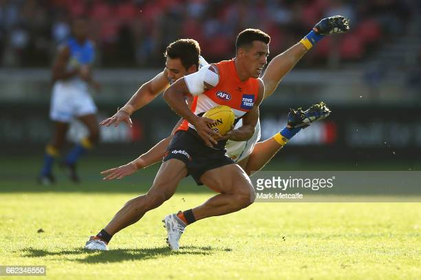 Dylan Shiel of the Giants takes on Jeremy Taylor of the Suns during the round two AFL match between the Greater Western Sydney Giants and the Gold...