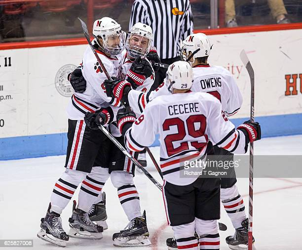 Dylan Sikura of the Northeastern Huskies celebrates his second of three goals on the night with his teammates Adam Gaudette Trevor Owens and Garrett...