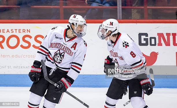 Dylan Sikura of the Northeastern Huskies celebrates his third goal of the game against the Minnesota Golden Gophers with teammate Adam Gaudette...