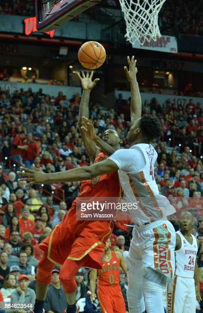 Dylan Smith of the Arizona Wildcats scores on a layup against Brandon McCoy of the UNLV Rebels during their game at the Thomas Mack Center on...