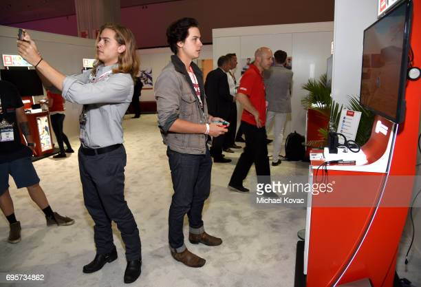 Dylan Sprouse and Cole Sprouse visit the Nintendo booth at the 2017 E3 Gaming Convention at Los Angeles Convention Center on June 13 2017 in Los...