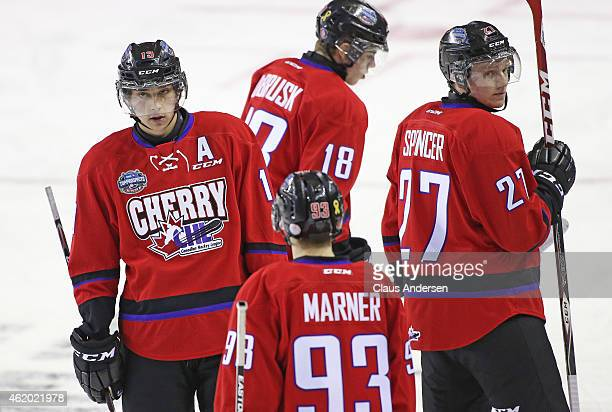 Dylan Strome and Matthew Spencer of Team Cherry look back waiting for a timeout to end against Team Orr in the 2015 BMO CHL/NHL Top Prospects Game at...