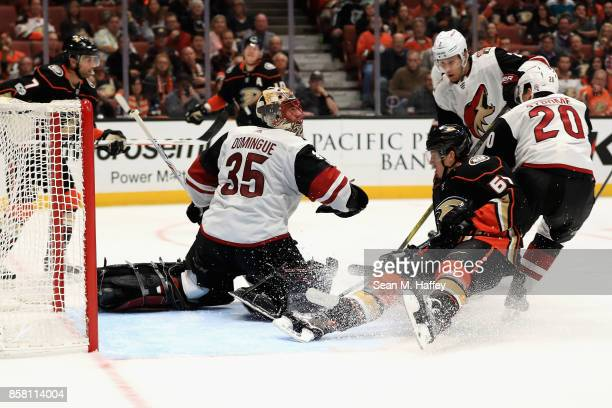 Dylan Strome Louis Domingue and Luke Schenn of the Arizona Coyotes defend against Rickard Rakell of the Anaheim Ducks during the third period of a...