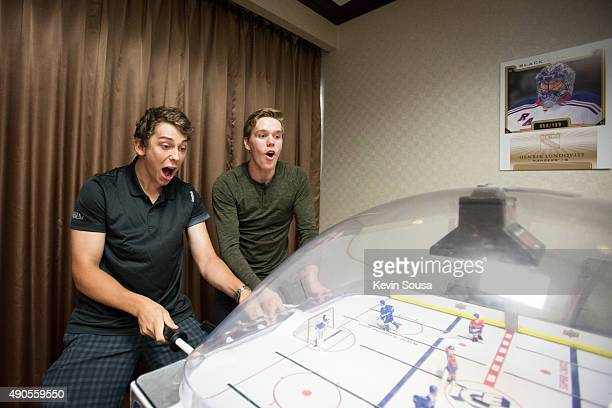 Dylan Strome of the Arizona Coyotes and Connor McDavid of the Edmonton Oilers challenge some friends to a game of table hockey during the 2015 NHLPA...