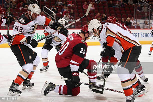 Dylan Strome of the Arizona Coyotes battles Corey Tropp of the Anaheim Ducks for a loose puck during the second period of the preseason NHL game at...