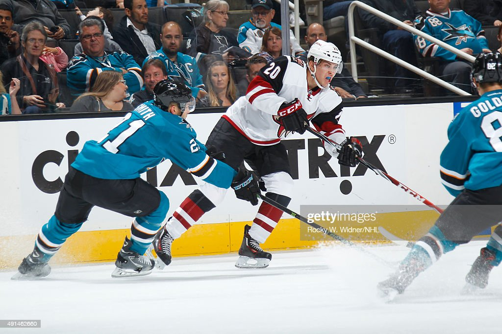 Dylan Strome #20 of the Arizona Coyotes passes the puck against Ben Smith #21 of the San Jose Sharks at SAP Center on September 25, 2015 in San Jose, California.