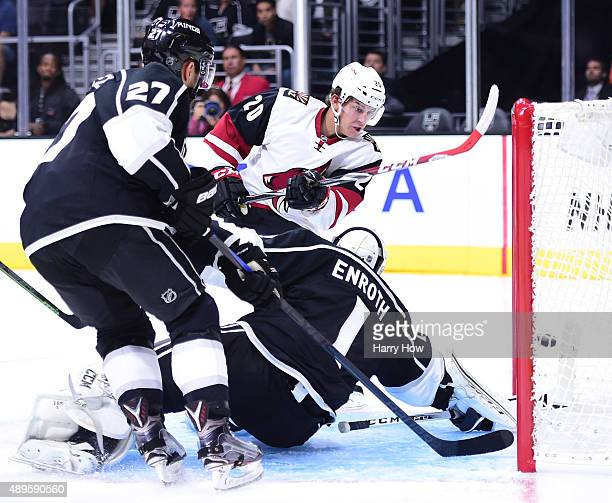 Dylan Strome of the Arizona Coyotes scores past Jhonas Enroth and Alec Martinez of the Los Angeles Kings during the first period of a preseason game...