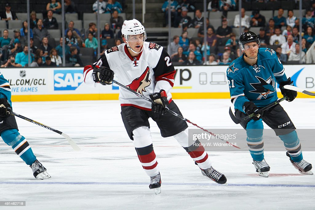 Dylan Strome #20 of the Arizona Coyotes skates against Ben Smith #21 of the San Jose Sharks at SAP Center on September 25, 2015 in San Jose, California.