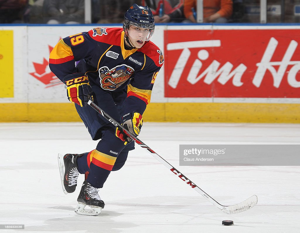 Dylan Strome #19 of the Erie Otters skates with the puck against the London Knights during an OHL game at the Budweiser Gardens on October 25, 2013 in London, Ontario, Canada. The Otters defeated the Knights 5-1.