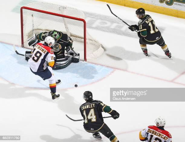 Dylan Strome of the Erie Otters tries to get a shot on Tyler Parsons of the London Knights during an OHL game at Budweiser Gardens on March 10 2017...
